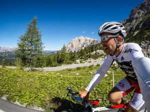 Climbing the Passo Valparola with view on the Conturines mountain